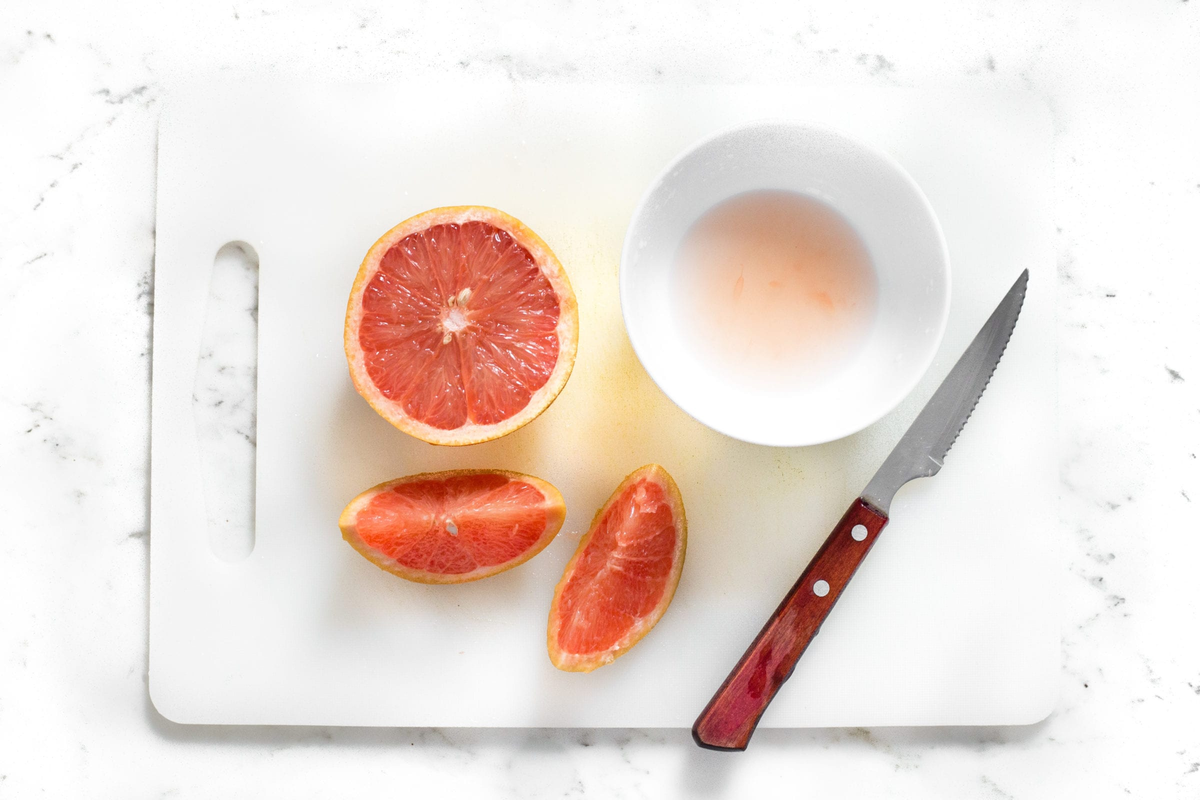 image of cut grapefruit on cutting board