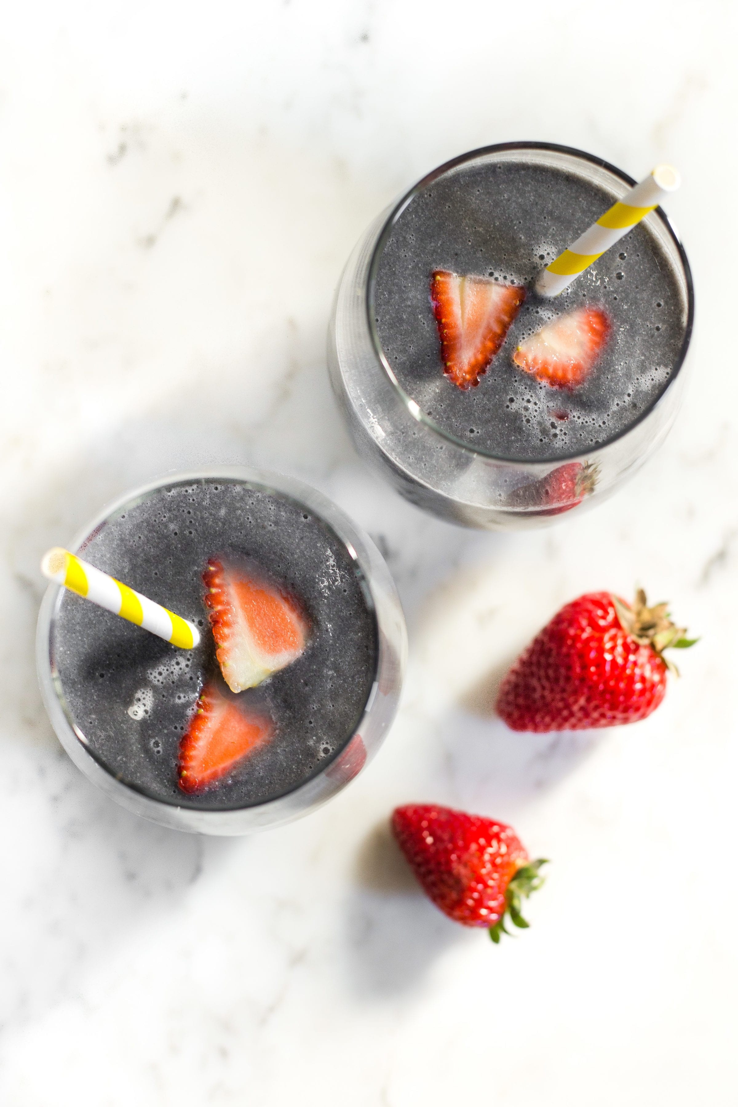 image of two glasses of activated charcoal smoothie